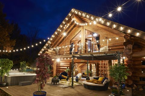 the cabins day bed and outdoor seating area