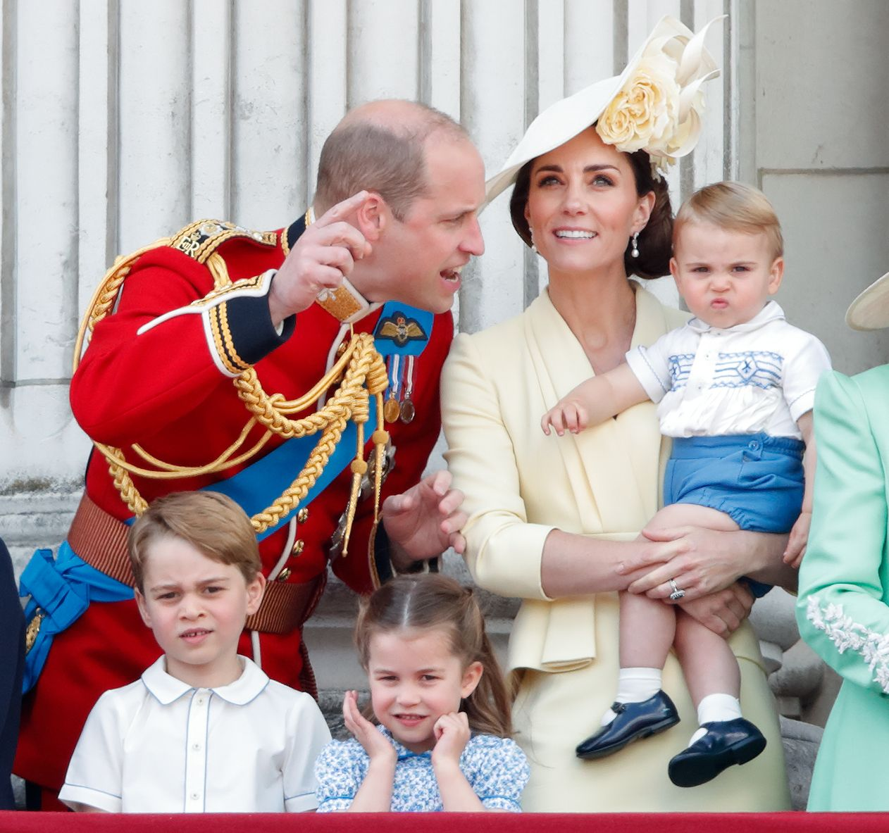 The Cambridge children cuddle up to Prince William in a new behind-the-scenes photo