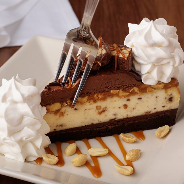 the cheesecake factory chocolate caramelicious cheesecake made with snickers
