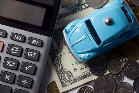 The concept of saving money for travel, buy a dream car and car repairs.