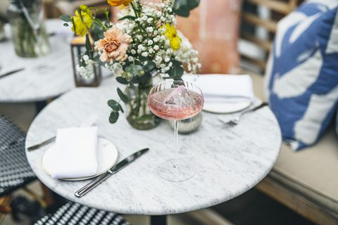 Photograph, Table, Green, Rehearsal dinner, Yellow, Brunch, Tablecloth, Furniture, Flower, Centrepiece,