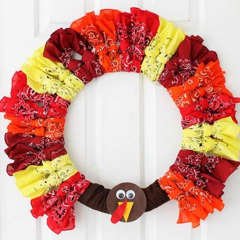 turkey wreath made of scrunched bandanas in different colors with a brown face with googly eyes