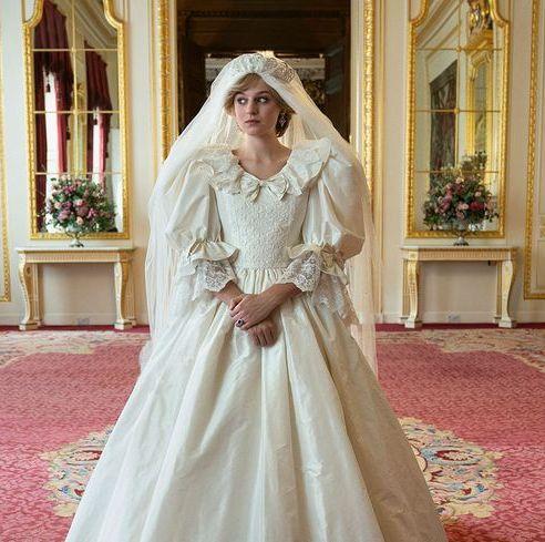 Sleeve, Dress, Textile, Bridal clothing, Flooring, Floor, Bridal veil, Room, Interior design, Gown,