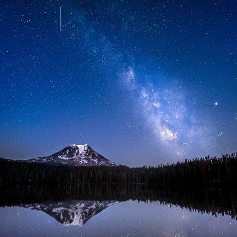 The Delta Aquariid meteor shower and the Milky Way over MT Adams on Lake Takhlakh in Washington State
