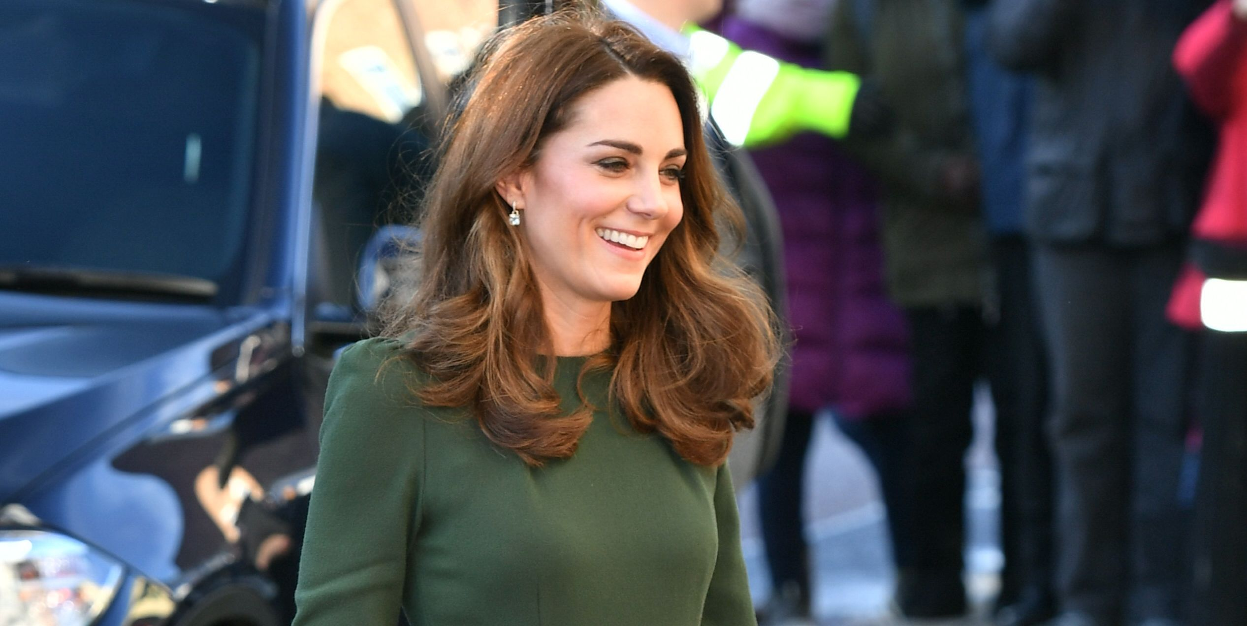 Kate Middleton Wears a Green Belted Midi Dress to Visit Family Action Charity