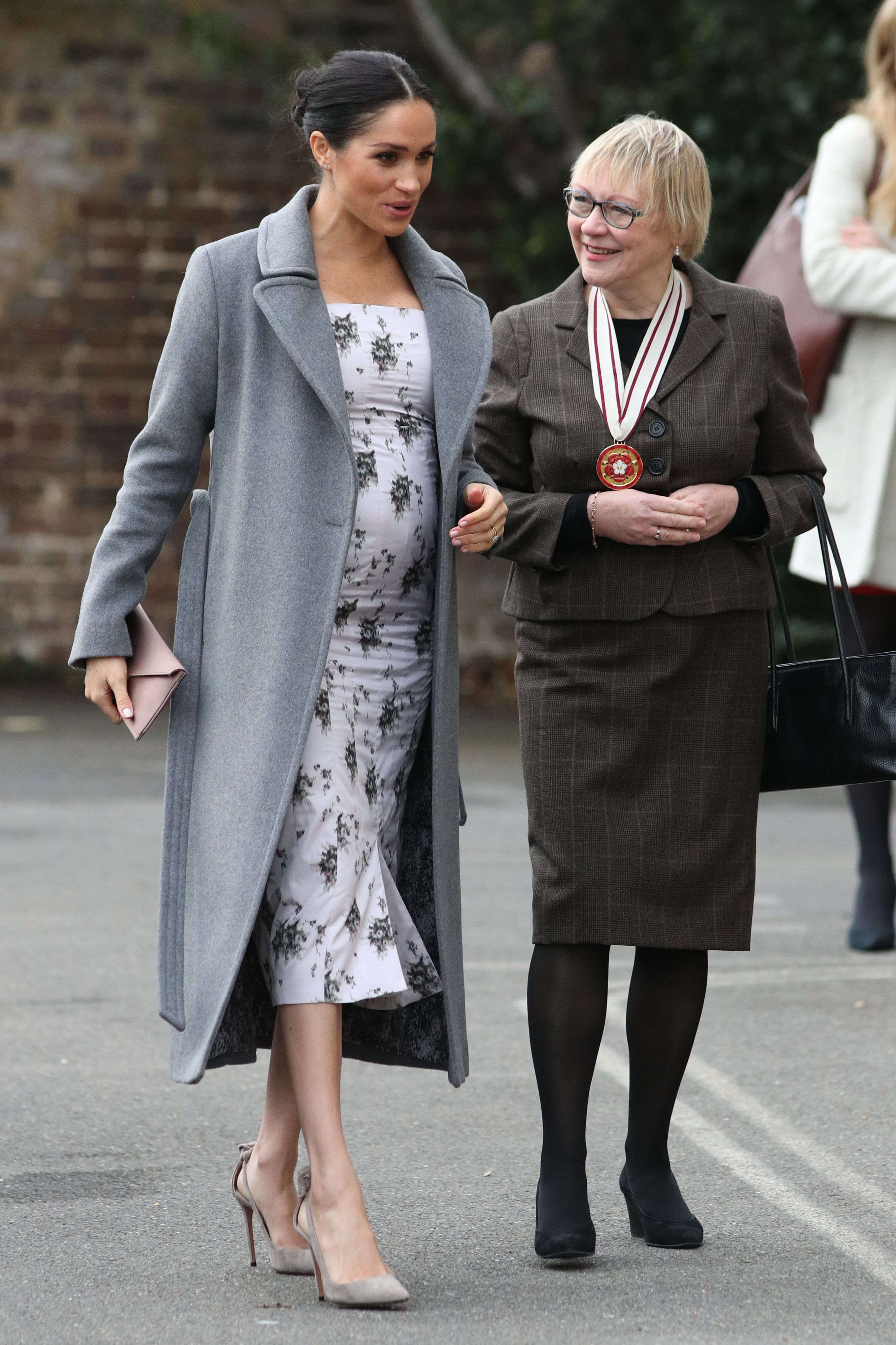 She wrapped up in a chic gray coat, too.