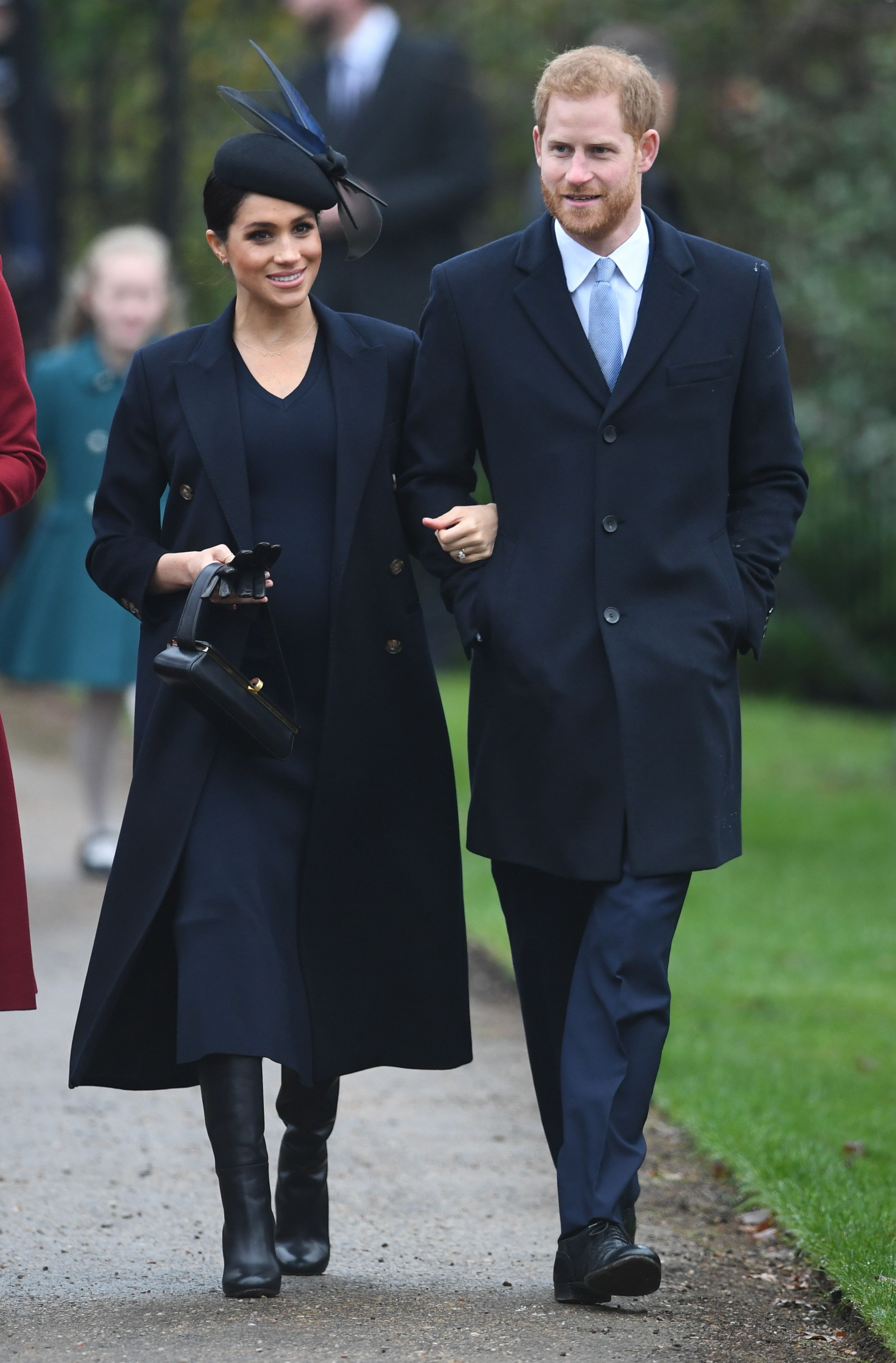 Harry and Meghan joined the rest of the royal family for church on Christmas Day in Sandringham . The Duchess wore a navy coat and dress by Victoria Beckham with a Philip Treacy hat and matching boots.