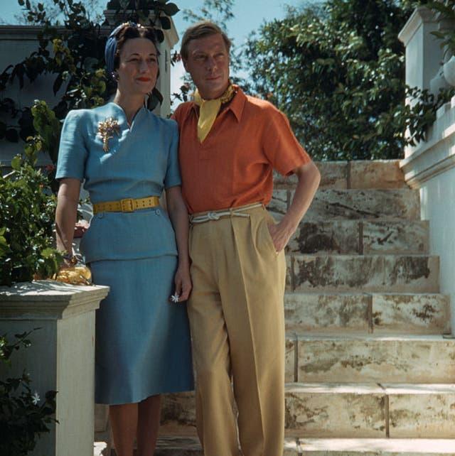 duke and duchess standing on steps