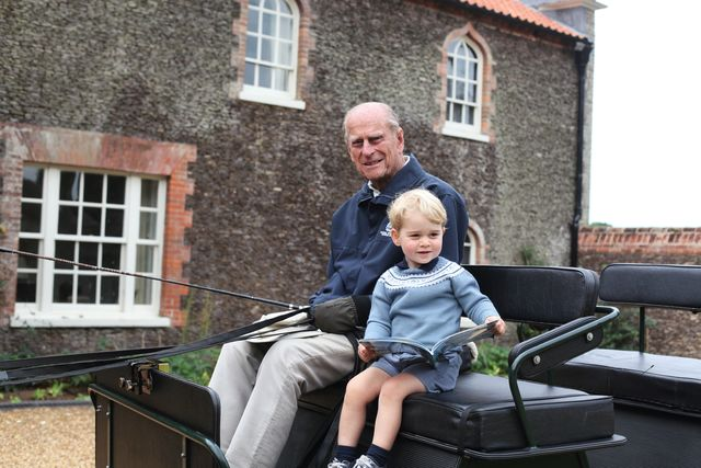 prince philip and prince george in a carriage