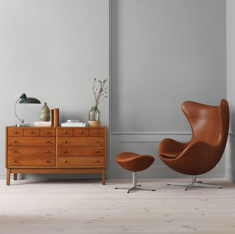 Furniture, Chest of drawers, Chair, Room, Floor, Wall, Interior design, Drawer, Orange, Wood,