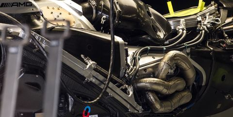 The engine of the Mercedes W10 in the pits during previews...