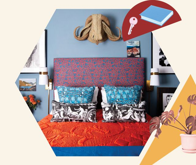the first apartment bedroom, blue painted walls, red and blue headboard, decorative pillows, wall decor