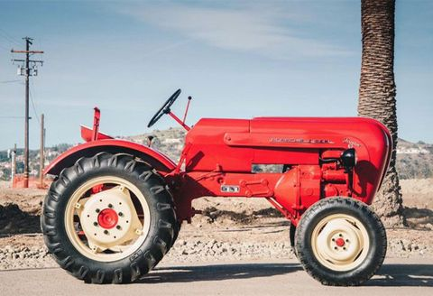 Land vehicle, Tractor, Vehicle, Agricultural machinery, Red, Mode of transport, Car, Wheel, Tire, Automotive wheel system,