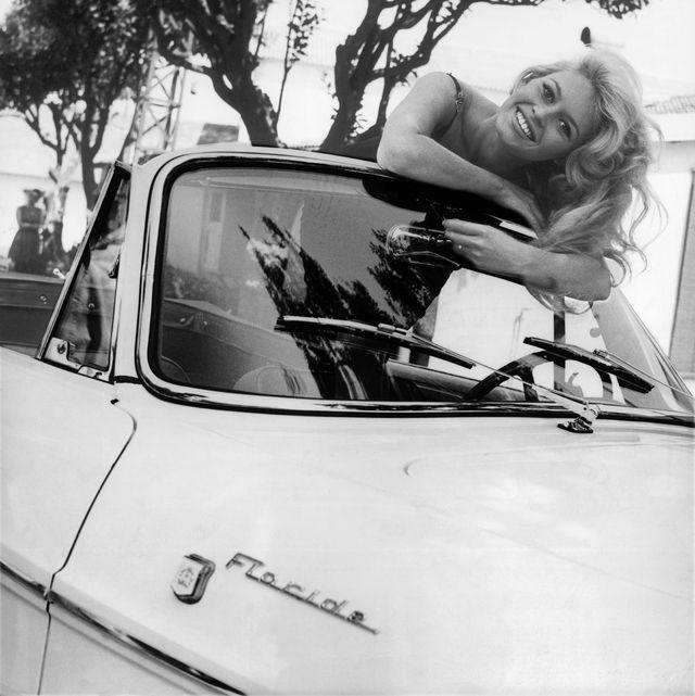 brigitte bardot in a car between 1958 1965