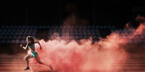 athlete running in red smoke