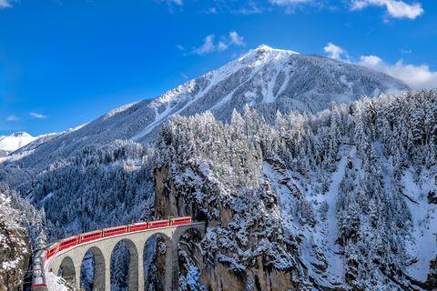 Mountain, Mountainous landforms, Snow, Mountain range, Winter, Sky, Alps, Transport, Geological phenomenon, Hill station,