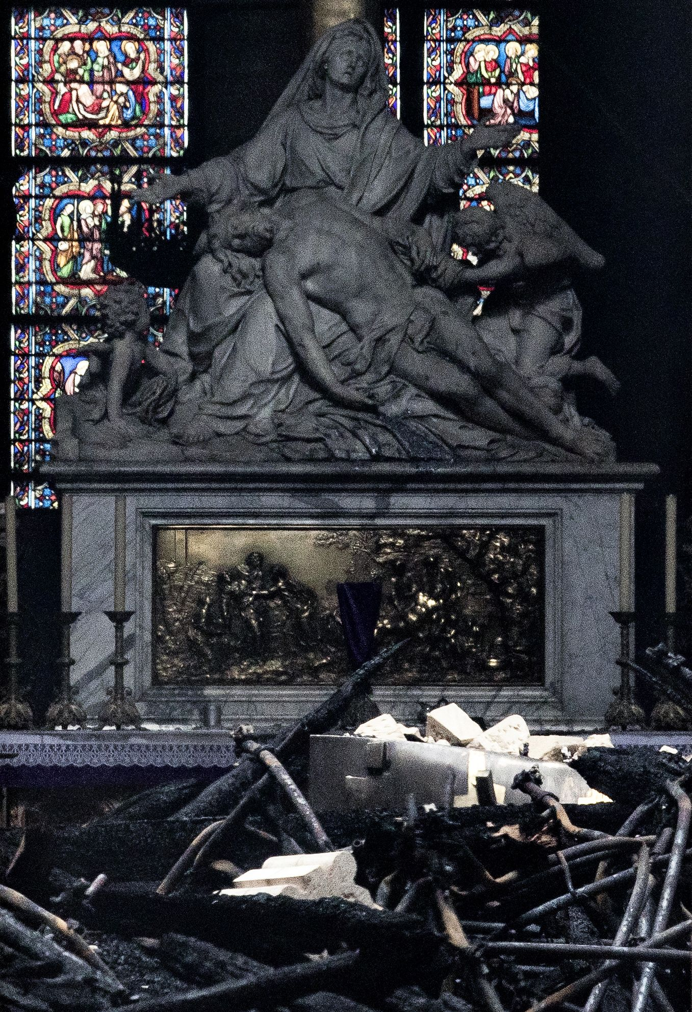 Paris Assesses Damage Following Notre Dame Blaze pieta fire damage