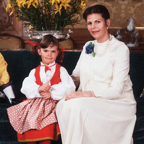 the king and queen of sweden with their two children