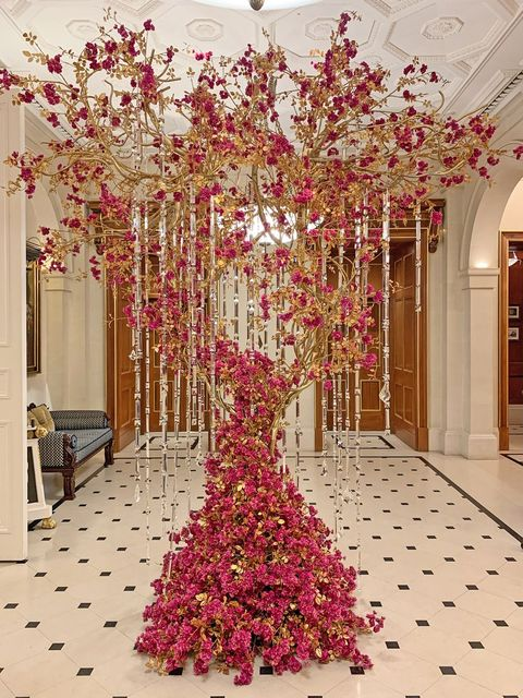 Decoration, Pink, Tree, Flower, Aisle, Plant, Branch, Floral design, Petal, Room,
