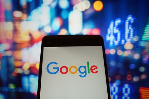 The logo of google is seen in a smartphone...