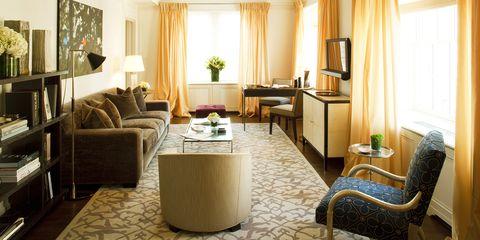 Room, Living room, Furniture, Interior design, Property, Suite, Building, Curtain, Floor, Table,