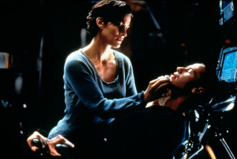 Carrie-Anne Moss, who plays Trinity in The Matrix , tends to Keanu Reeves