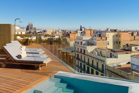Roof, Property, Sky, Daytime, Architecture, Town, Real estate, Building, Residential area, Human settlement,