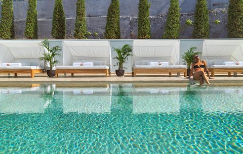 Swimming pool, Leisure, Property, Water, Resort, Leisure centre, Architecture, Reflecting pool, Real estate, Outdoor furniture,