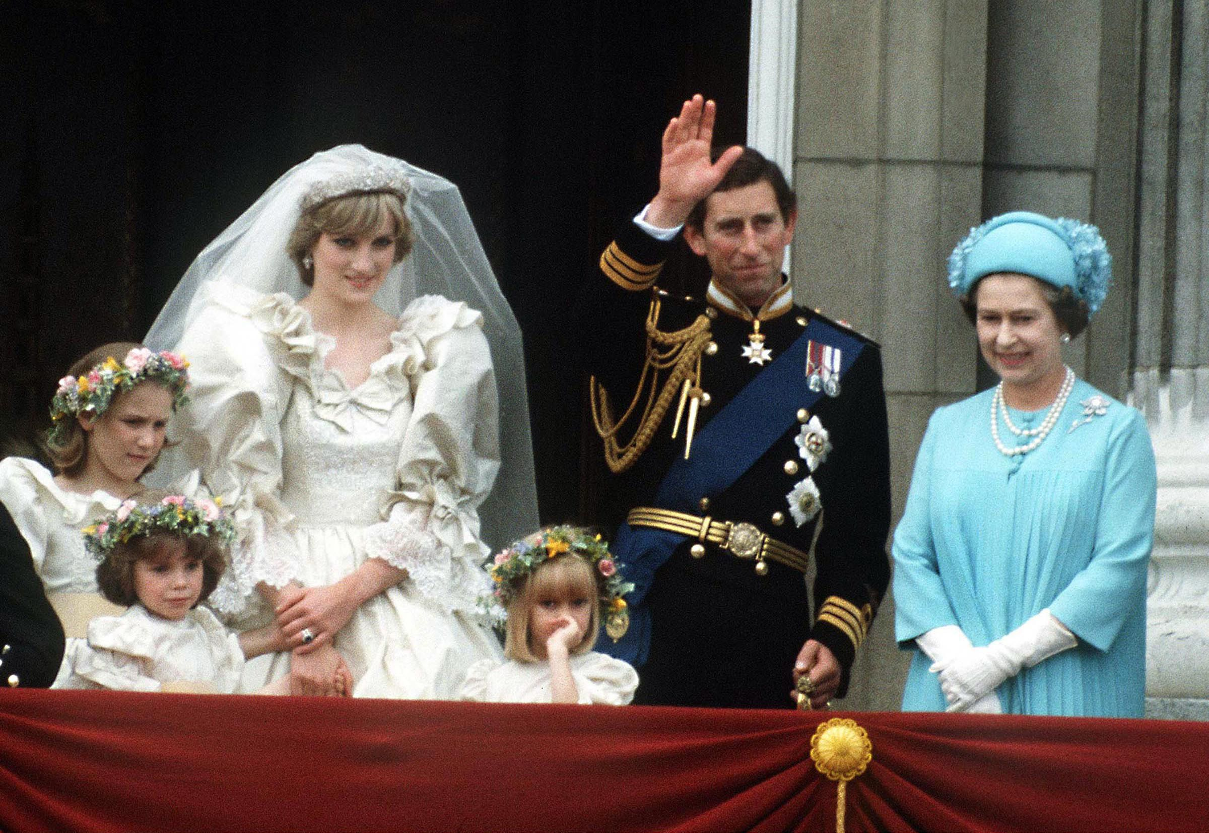 The original headline-grabbing royal wedding, Prince Charles's marriage to Diana Spencer in 1981 was an international event, watched by millions worldwide. For the occasion of the future King of England's nuptials, the queen sported a shift dress in Tiffany blue with white elbow-length gloves, pearls, and a matching hat.