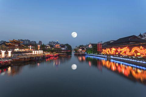 the qinhuai river in nanjing, jiangsu province of china a full moon in the night