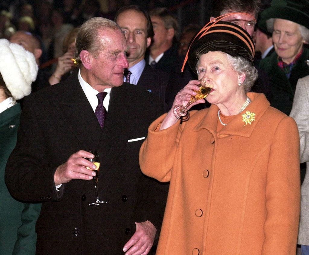 The Queen drinking