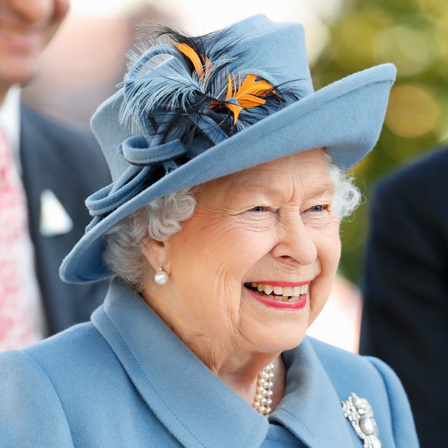 the queen, seen here laughing in a blue hat and skirt suit, just gave a glimpse into in her personality