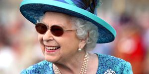 The Queen wearing sunglasses