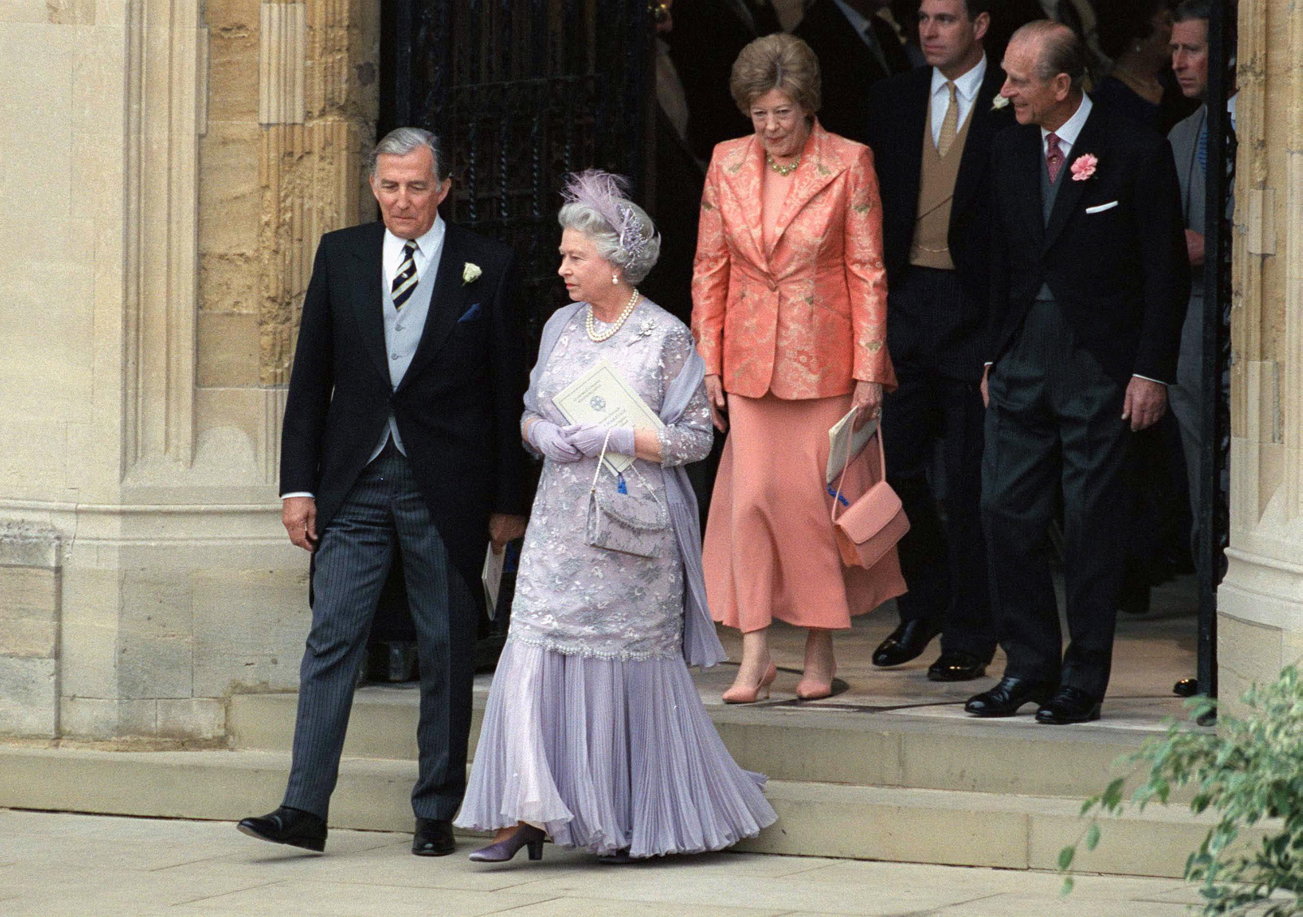 In 1999, Queen Elizabeth's youngest, Prince Edward , married Sophie Rhys-Jones in a relatively private ceremony (by royal standards, at least). Break from her blue streak, the Queen fashioned herself in a muted lilac palette for the occasion, donning a beaded dress with sheer sleeves and a pleated hem along with matching gloves and a feathered fascinator.