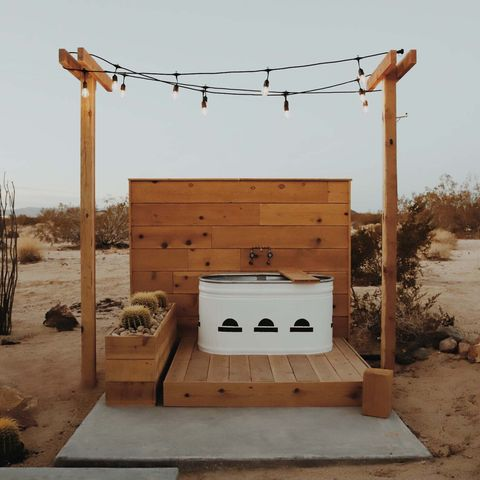 outdoor tub on deck with string lights
