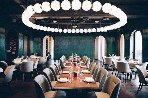 Restaurant, Function hall, Interior design, Room, Lighting, Building, Ceiling, Table, Architecture, Dining room,