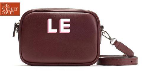 Bag, Messenger bag, Fashion accessory, Brown, Coin purse, Handbag, Zipper, Material property, Font, Rectangle,