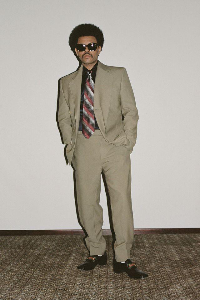suit, clothing, formal wear, blazer, pantsuit, standing, outerwear, tuxedo, fashion, human,