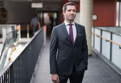Suit, Photograph, Clothing, Formal wear, White-collar worker, Blazer, Outerwear, Tuxedo, Standing, Businessperson,