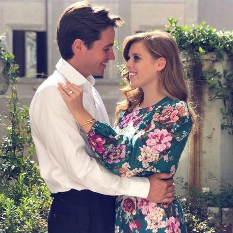 Facial expression, Romance, Love, Beauty, Dress, Fashion, Interaction, Smile, Formal wear, Outerwear,