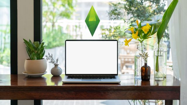 a computer on a desk with the sims green gem indicator floating above it