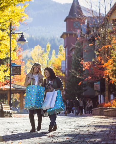 two female friends excited about shopping during thanksgiving season