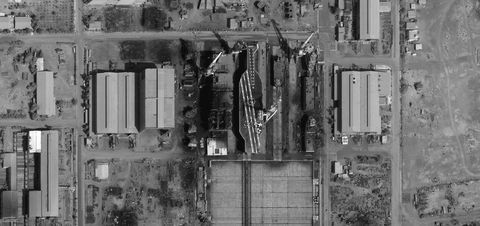 This is a close-up DigitalGlobe Satellite Imagery showing the construction of what appears to be a fake mock-up of a U.S. aircraft carrier near Bostanu, Iran.
