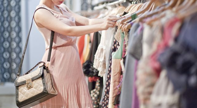 this is when the shops closed in lockdown are set to reopen again and you can resume clothes shopping picture shows a woman browsing a rail of clothes
