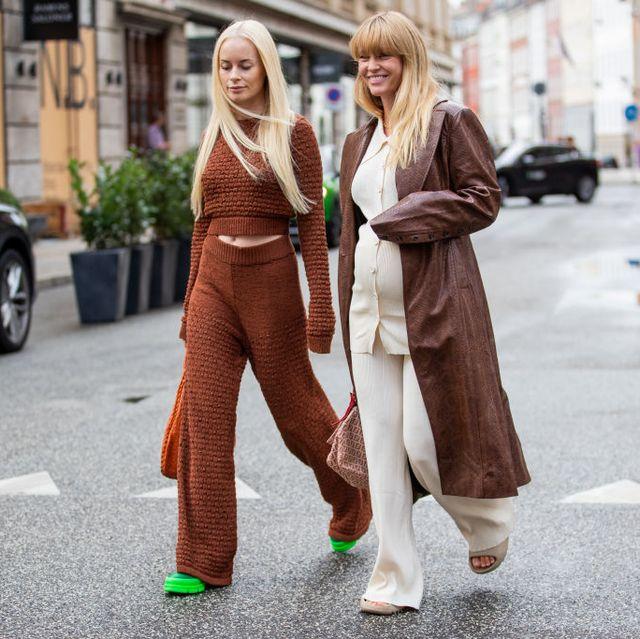 two women at copenhagen fashion week 2022 wearing matching knitwear sets