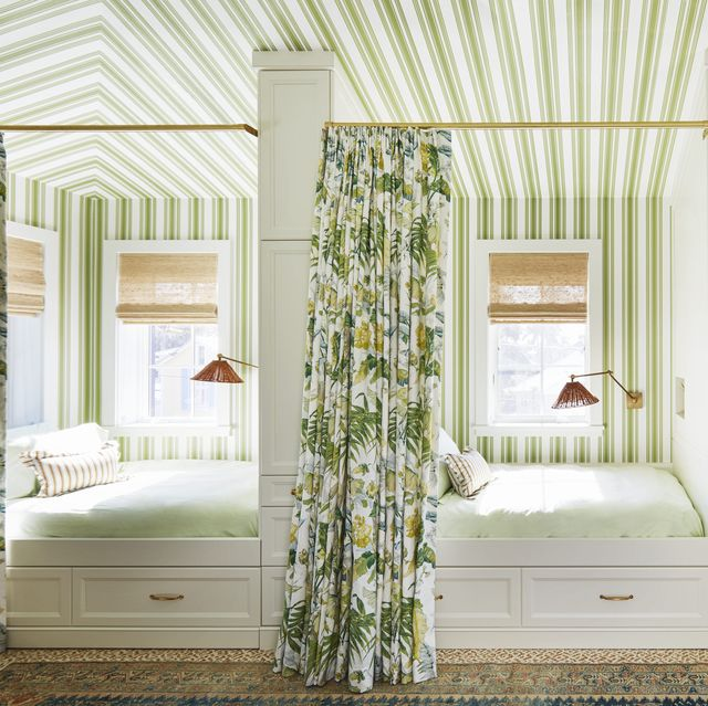 tented stripes transform a space over the garage into cabana style guest quarters