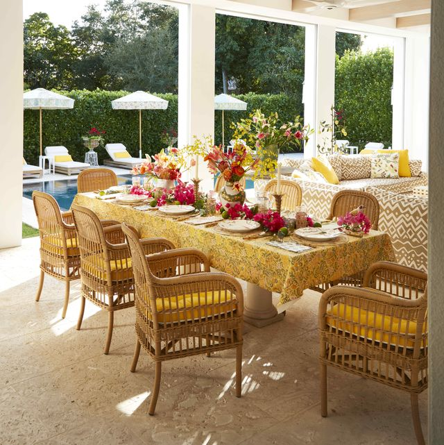 a radiant florida lanai with canvas seat cushions in sunshine yellow dress wicker porch seating