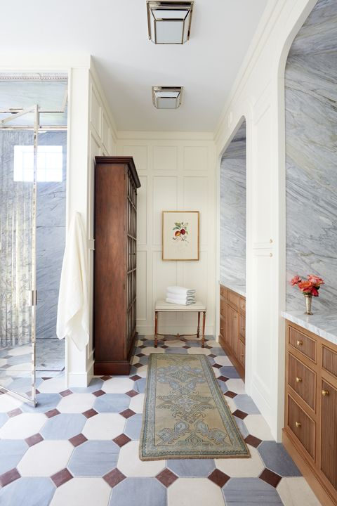graphic flooring tile in the primary bath marries limestone with gray and mahogany marble