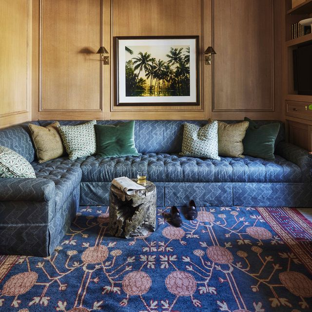 a tufted indigo sectional  turns the study into a corner hideaway