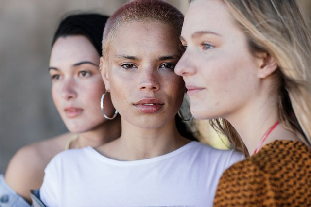 three beautiful young women looking various directions